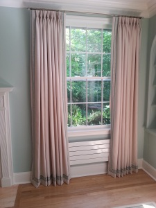 Pinch pleated curtains with custom trim